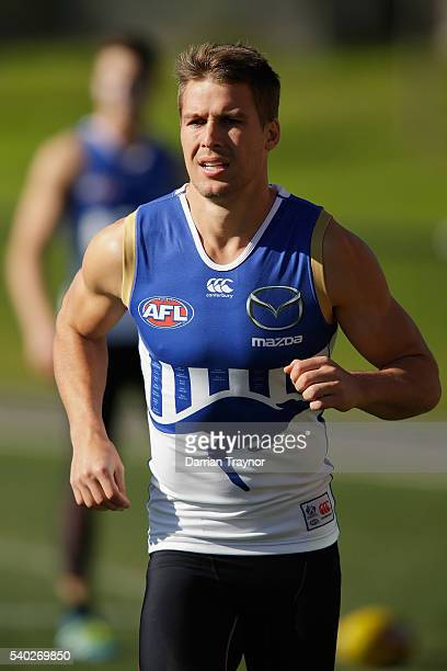 Andrew Swallow takes part in running drills during a North Melbourne Kangaroos AFL training session at Arden Street Ground on June 15 2016 in...