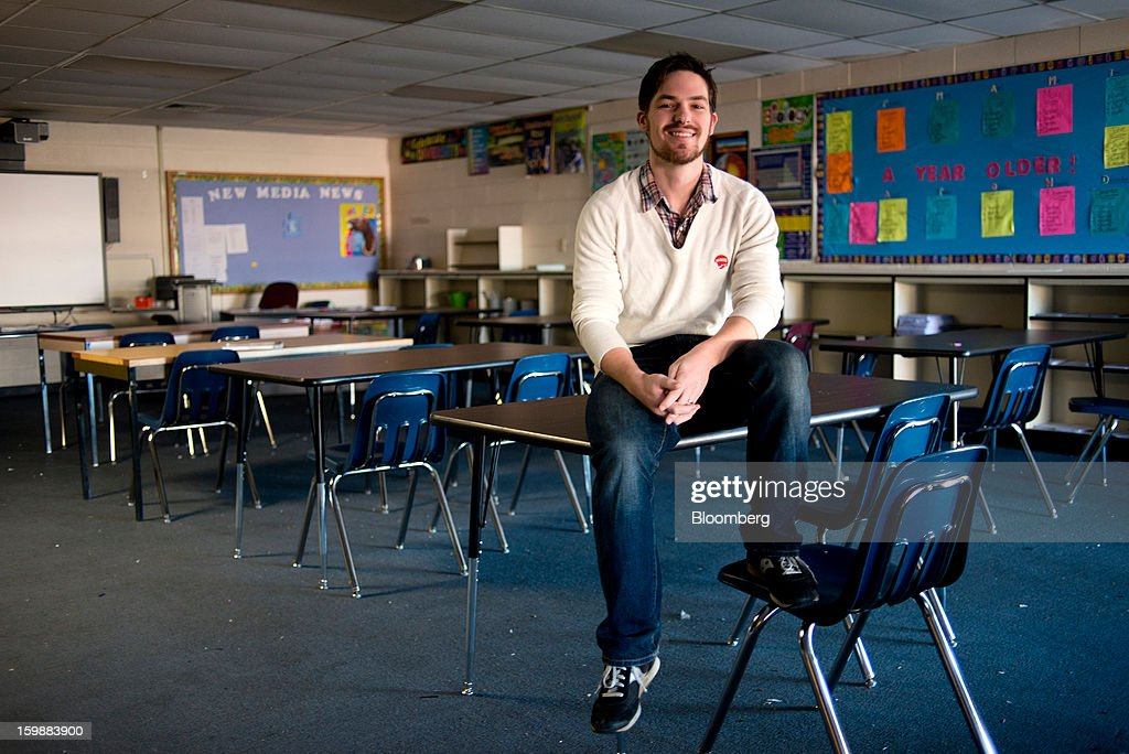 Andrew Sweigard, school principal, sits for a photograph inside a classroom at the The Academy of New Media Middle School in Columbus, Ohio, U.S. on Saturday, Jan. 19, 2013. $250,000 in gifts from the Walton Family Foundation keeps the 85-student charter school alive. In the aftermath of the Dec. 14 massacre of 26 school personnel and pupils in Newtown, Connecticut, Sweigard said he's worried that its angel may be tarnished. Walton family members own more than 48 percent of Wal-Mart Stores Inc., the largest seller of guns in the U.S. Photographer: Ty Wright/Bloomberg via Getty Images
