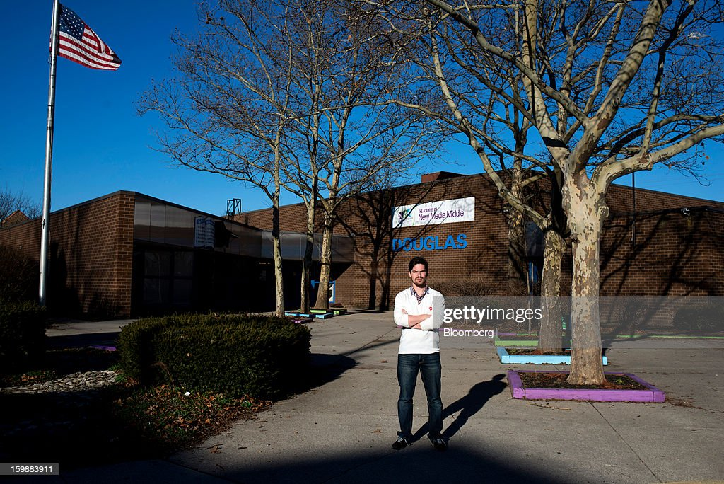 Andrew Sweigard, school principal, stands for a photograph in front of The Academy of New Media Middle School in Columbus, Ohio, U.S. on Saturday, Jan. 19, 2013. $250,000 in gifts from the Walton Family Foundation keeps the 85-student charter school alive. In the aftermath of the Dec. 14 massacre of 26 school personnel and pupils in Newtown, Connecticut, Sweigard said he's worried that its angel may be tarnished. Walton family members own more than 48 percent of Wal-Mart Stores Inc., the largest seller of guns in the U.S. Photographer: Ty Wright/Bloomberg via Getty Images