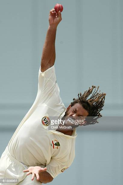 Andrew Symonds of Australia bowls during day two of the third test match between the West Indies and Australia at Kensington Oval on June 13 2008 in...