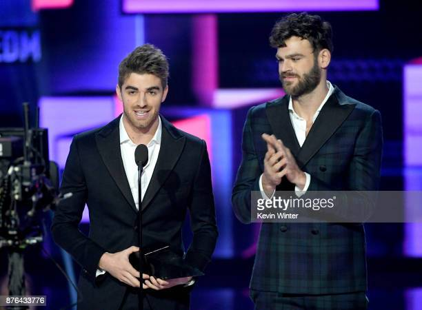 Andrew Taggart and Alex Pall of music group The Chainsmokers accept the Favorite Artist Electronic Dance Music award onstage during the 2017 American...