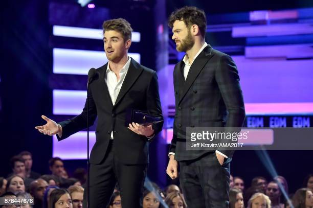 Andrew Taggart and Alex Pall of The Chainsmokers onstage during the 2017 American Music Awards at Microsoft Theater on November 19 2017 in Los...