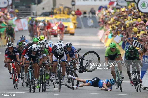 Andrew Talansky of the United States and GarminSharp crashes in the sprint to the finish line in stage seven of the 2014 Le Tour de France from...