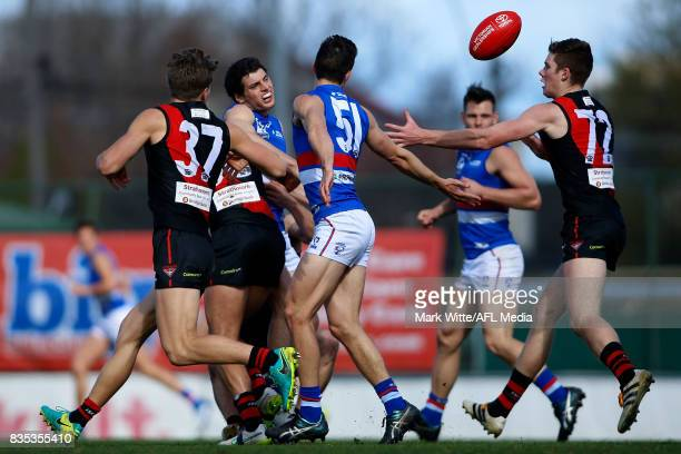 Andrew TashevskiBeckwith of Footscray Bulldogs gets tackled by a pack of bombers during the round 18 VFL match between the Essendon Bombers and...