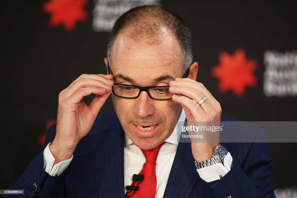 Andrew Thorburn, chief executive officer of National Australia Bank Ltd. (NAB), adjusts his glasses during a news conference in Sydney, Australia, on Thursday, May 5, 2016. National Australia posted a 6.5 percent increase in first-half cash profit as it bucked a trend among Australia's largest lenders by decreasing bad-debt charges and as margins improved for the first time since 2011. Photographer: Brendon Thorne/Bloomberg via Getty Images
