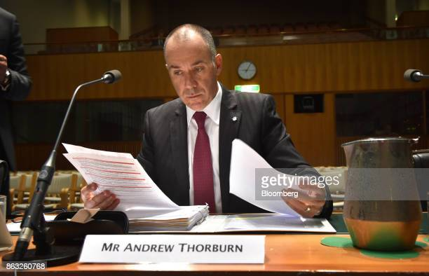Andrew Thorburn chief executive officer of National Australia Bank Ltd reads documents ahead of a hearing before the House of Representatives...