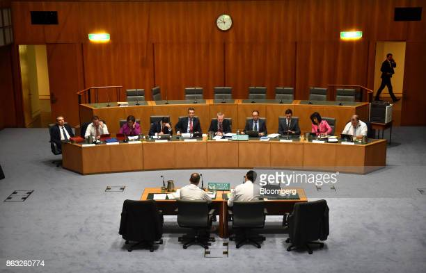 Andrew Thorburn chief executive officer of National Australia Bank Ltd foreground left appears before the House of Representatives Standing Committee...