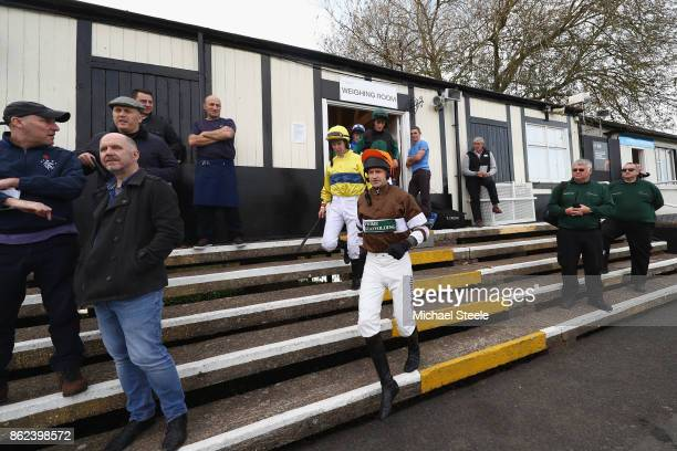 Andrew Thornton leads out fellow jockeys on his return to riding after a ten month injury lay off at Worcester Racecourse on October 17 2017 in...