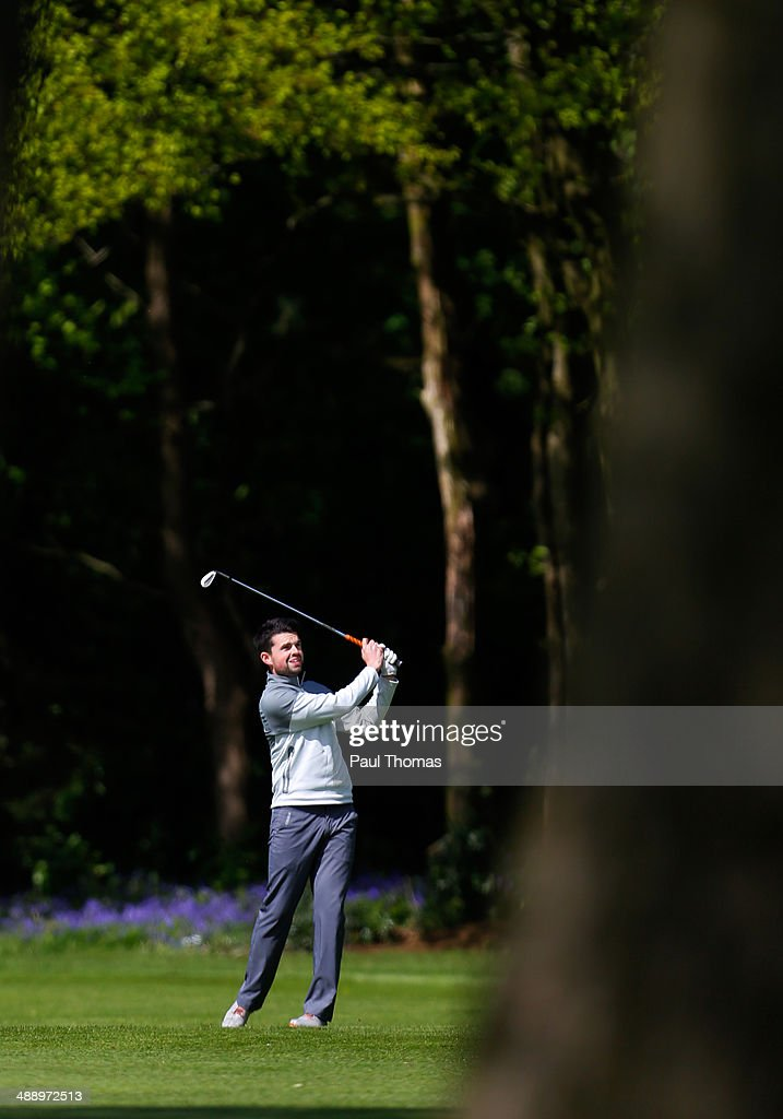 Andrew Thorpe of Peterborough Milton Golf Club plays a shot on the 18th hole during the Glenmuir PGA Professional Championship Midlands Regional Qualifier at Little Aston Golf Club on May 9, 2014 in Sutton Coldfield, England.