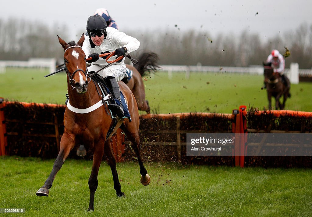 Andrew Tinkler riding Clemency clear the last to win The TurfTV Mares' Novices' Hurdle Race at Huntingdon racecourse on January 06 2016 in Huntingdon...