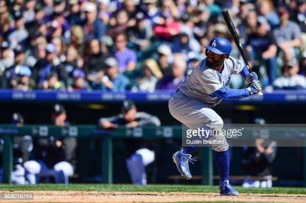 Andrew Toles of the Los Angeles Dodgers bats against the Colorado Rockies in the sixth inning of a game at Coors Field on April 9 2017 in Denver...