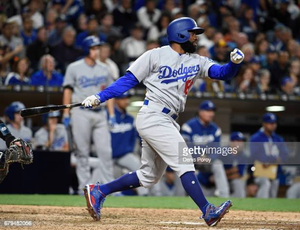 Andrew Toles of the Los Angeles Dodgers hits an RBI double during the seventh inning of a baseball game against the San Diego Padres at PETCO Park on...