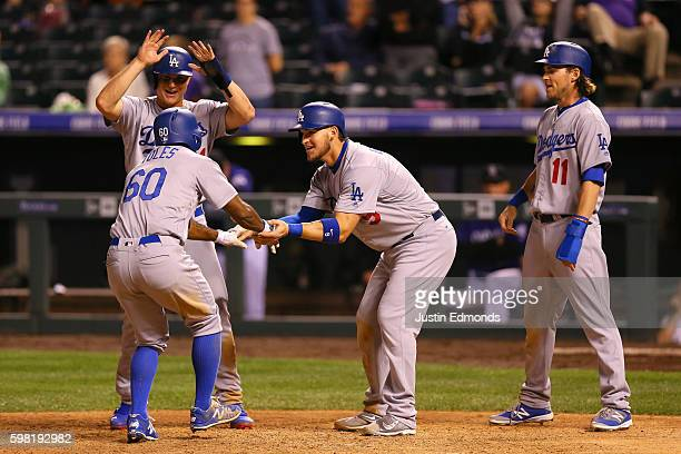 Andrew Toles of the Los Angeles Dodgers is greeted at home plate by Joc Pederson Yasmani Grandal and Josh Reddick after hitting a goahead grand slam...