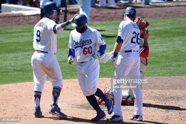 Andrew Toles of the Los Angeles Dodgers returns home after hitting a three run homerun in the sixth inning against the Philadelphia Phillies at...