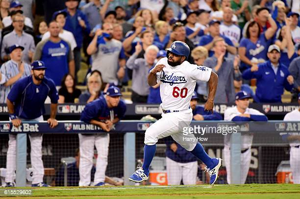 Andrew Toles of the Los Angeles Dodgers rounds third to score a run in the third inning on a hit by Corey Seager against the Chicago Cubs in game...