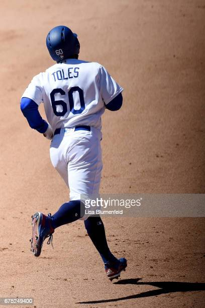 Andrew Toles of the Los Angeles Dodgers runs the bases after hitting a three run homerun in the sixth inning against the Philadelphia Phillies at...