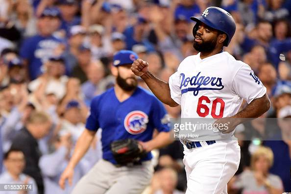 Andrew Toles of the Los Angeles Dodgers scores a run in the third inning on a hit by Corey Seager against the Chicago Cubs in game three of the...