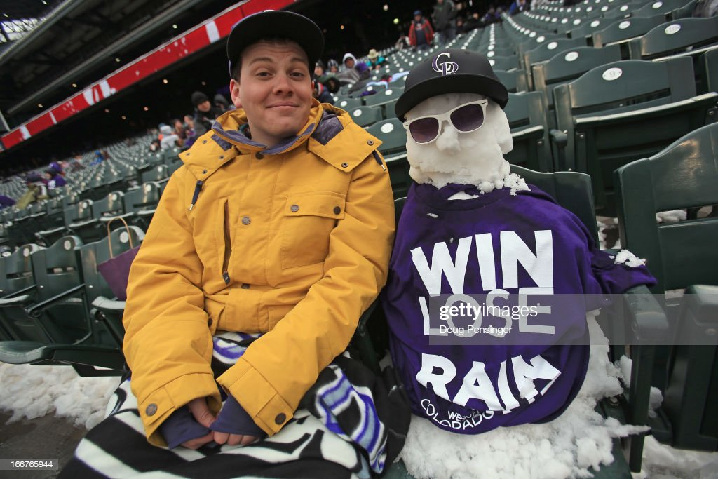 Andrew Tollerud of Lakewood, Colorado takes in the game between the New York Mets and the Colorado Rockies with his snowman companion at Coors Field on April 16, 2013 in Denver, Colorado. All uniformed team members are wearing jersey number 42 in honor of Jackie Robinson Day.