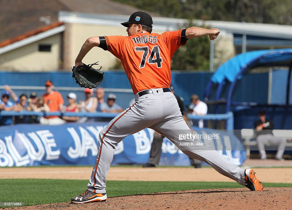 Andrew Triggs #74 of the Baltimore Orioles pitches in the fourth inning during the game against the Toronto Blue Jays at Florida Auto Exchange Stadium on March 4, 2016 in Dunedin, Florida.