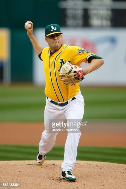 Andrew Triggs of the Oakland Athletics pitches against the Los Angeles Angels of Anaheim during the first inning at the Oakland Coliseum on April 6...