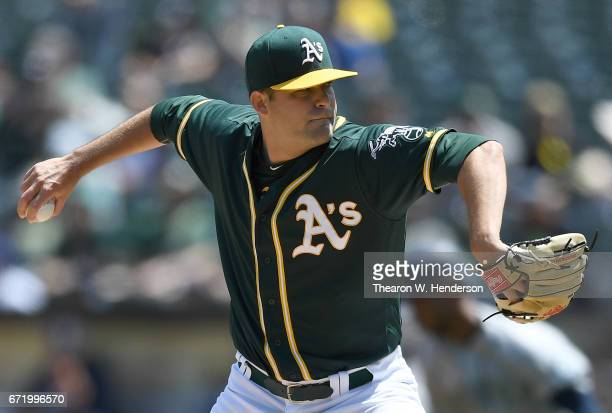 Andrew Triggs of the Oakland Athletics pitches against the Seattle Mariners in the top of the first inning at Oakland Alameda Coliseum on April 23...