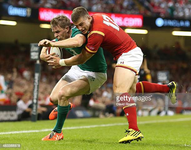 Andrew Trimble of Ireland is knocked into touch by Wales centre Scott Williams during the International match between Wales and Ireland at the...