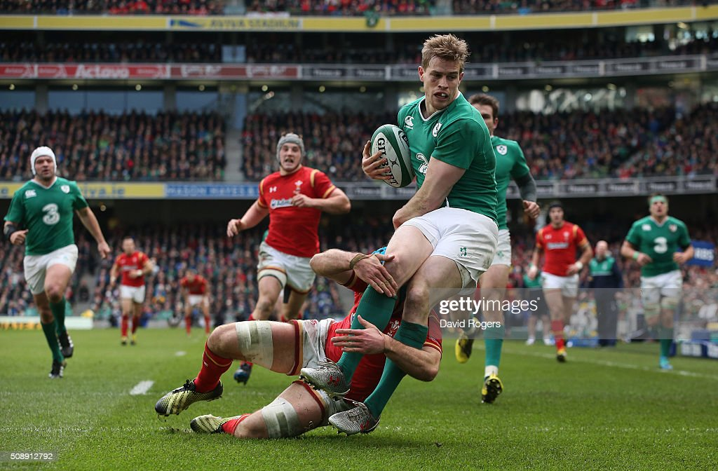 <a gi-track='captionPersonalityLinkClicked' href=/galleries/search?phrase=Andrew+Trimble&family=editorial&specificpeople=544137 ng-click='$event.stopPropagation()'>Andrew Trimble</a> of Ireland is tackled by <a gi-track='captionPersonalityLinkClicked' href=/galleries/search?phrase=Justin+Tipuric&family=editorial&specificpeople=6739194 ng-click='$event.stopPropagation()'>Justin Tipuric</a> of Wales adfter carrying the ball over his own tryline during the RBS Six Nations match between Ireland and Wales at the Aviva Stadium on February 7, 2016 in Dublin, Ireland.