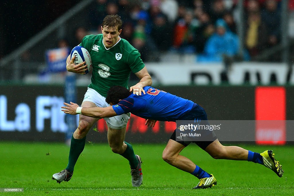 <a gi-track='captionPersonalityLinkClicked' href=/galleries/search?phrase=Andrew+Trimble&family=editorial&specificpeople=544137 ng-click='$event.stopPropagation()'>Andrew Trimble</a> of Ireland is tackled by Sebastien Bezy of France during the RBS Six Nations match between France and Ireland at the Stade de France on February 13, 2016 in Paris, France.