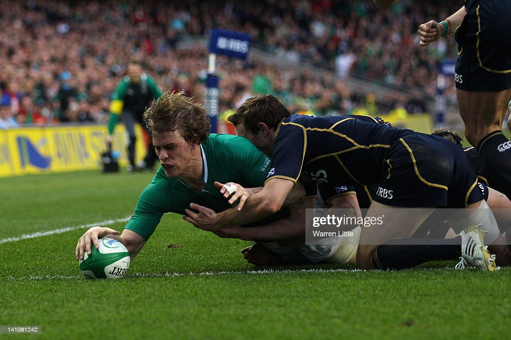 <a gi-track='captionPersonalityLinkClicked' href=/galleries/search?phrase=Andrew+Trimble&family=editorial&specificpeople=544137 ng-click='$event.stopPropagation()'>Andrew Trimble</a> of Ireland score a try during the RBS Six Nations match between Ireland and Scotland at Aviva Stadium on March 10, 2012 in Dublin, Ireland.