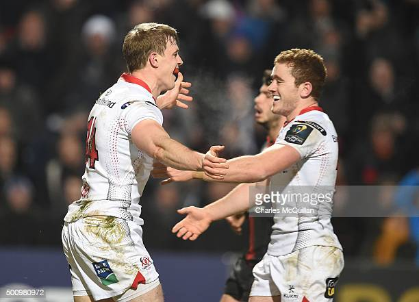 Andrew Trimble of Ulster celebrates with team mate Paddy Jackson after scoring a try during the European Champions Cup Pool 1 rugby game between...