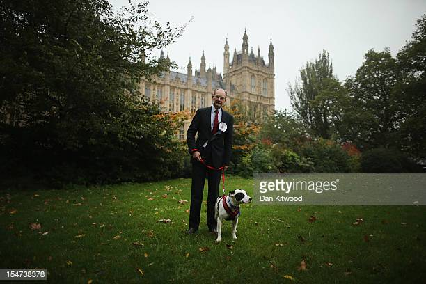 Andrew Turner Conservative MP for Dewsbury stands in front of The Houses of Parliament with his dog George a Wire Haired Fox Terrier during the...