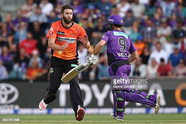 Andrew Tye of the Perth Scorchers braces himself before he collides with Jonathan Wells of the Hobart Hurricanes during the Big Bash League match...