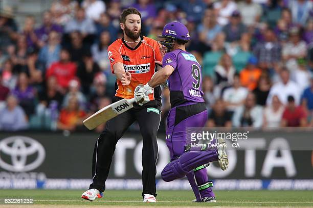 Andrew Tye of the Perth Scorchers collides with Jonathan Wells of the Hobart Hurricanes during the Big Bash League match between the Hobart...