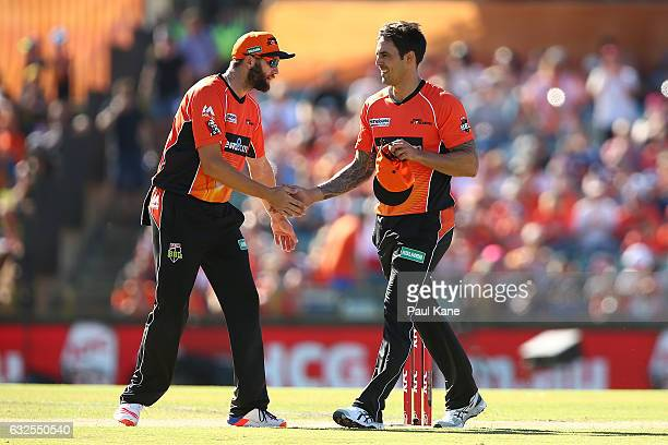 Andrew Tye of the Scorchers acknowledges Mitchell Johnson after his first over during the Big Bash League match between the Perth Scorchers and the...