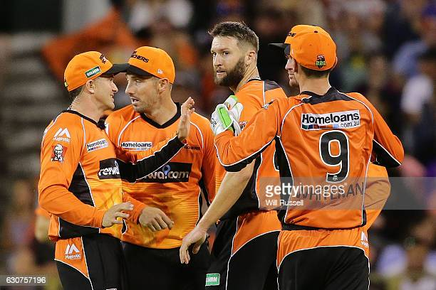 Andrew Tye of the Scorchers celebrates after taking the wicket of Ben Rohrer of the Thunder during the Big Bash League match between the Perth...
