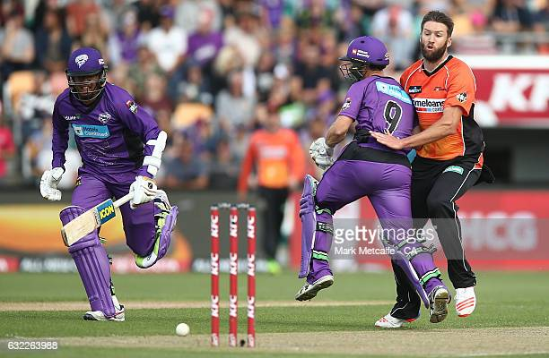 Andrew Tye of the Scorchers collides with Jon Wells of the Hurricanes during the Big Bash League match between the Hobart Hurricanes and the Perth...