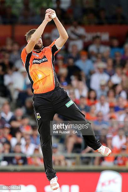 Andrew Tye of the Scorchers fields off his own bowling during the Big Bash League match between the Perth Scorchers and the Brisbane Heat at WACA on...