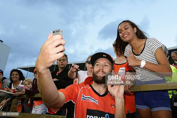 Andrew Tye of the Scorchers takes selfies with fans after the Big Bash League match between the Perth Scorchers and the Brisbane Heat at WACA on...