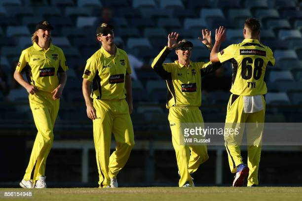 Andrew Tye of the Warriors celebrates after taking the wicket of Scott Boland of the Bushrangers during the JLT One Day Cup match between Victoria...