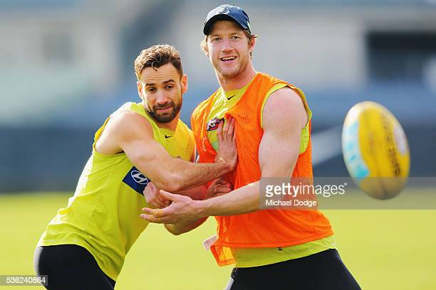 Andrew Walker of the Blues and Sam Rowe compete for the ball during the Carlton Blues AFL training session at Ikon Park on June 1 2016 in Melbourne...