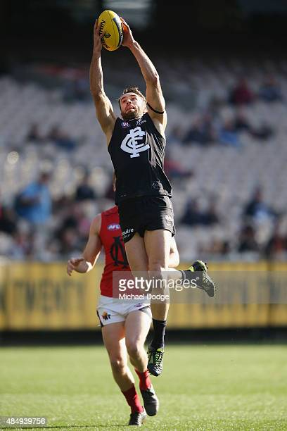 Andrew Walker of the Blues marks the ball during the round 21 AFL match between the Carlton Blues and the Melbourne Demons at Melbourne Cricket...