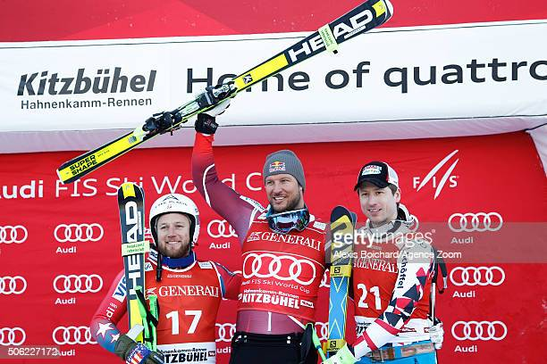 Andrew Weibrecht of the USA takes 2nd place Aksel Lund Svindal of Norway takes 1st place and Hannes Reichelt of Austria takes 3rd place during the...
