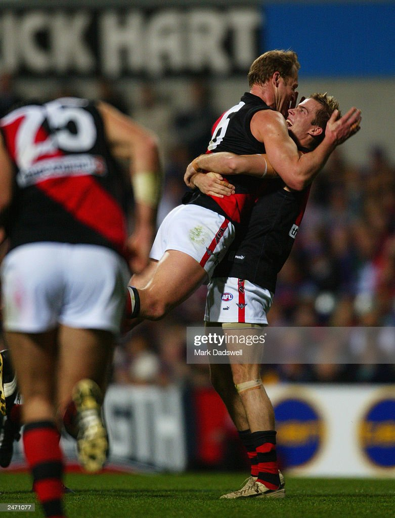 Andrew Welsh for the Bombers celebrates with Sean Wellman during the AFL First Elimination final between the Fremantle Dockers and the Essendon...