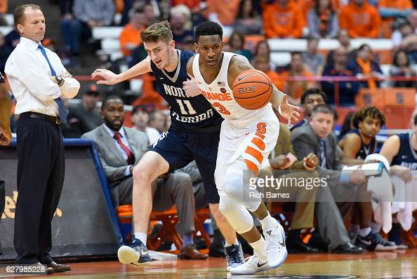 Andrew White III of the Syracuse Orange and Garrett Sams of the North Florida Ospreys battle for a loose ball during the second half at the Carrier...