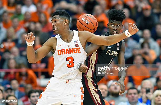 Andrew White III of the Syracuse Orange and Jonathan Isaac of the Florida State Seminoles battle for a loose ball during the first half at the...