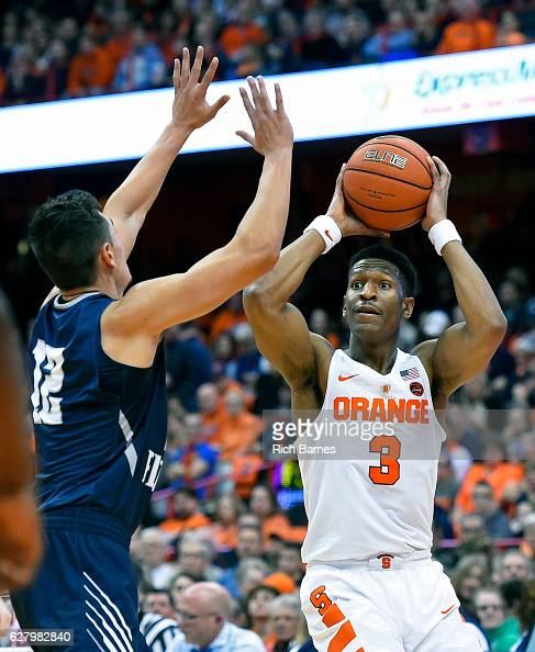 Andrew White III of the Syracuse Orange controls the ball as Aaron Bodager of the North Florida Ospreys defends during the first half at the Carrier...