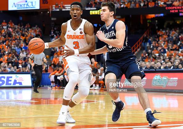 Andrew White III of the Syracuse Orange drives to the basket against the defense of Benedikt Haid of the North Florida Ospreys during the first half...