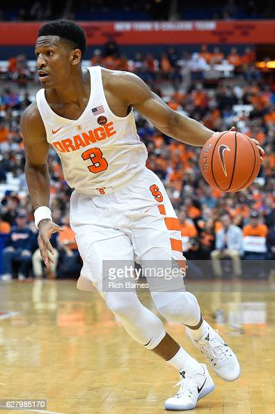 Andrew White III of the Syracuse Orange drives to the basket against the North Florida Ospreys during the second half at the Carrier Dome on December...