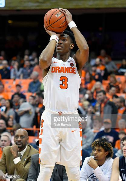 Andrew White III of the Syracuse Orange shoots the ball against the North Florida Ospreys during the first half at the Carrier Dome on December 3...