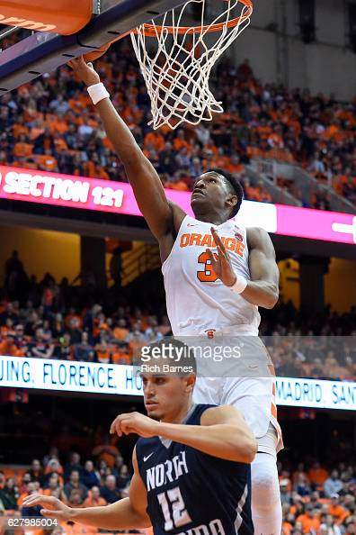 Andrew White III of the Syracuse Orange shoots the ball over Aaron Bodager of the North Florida Ospreys during the second half at the Carrier Dome on...